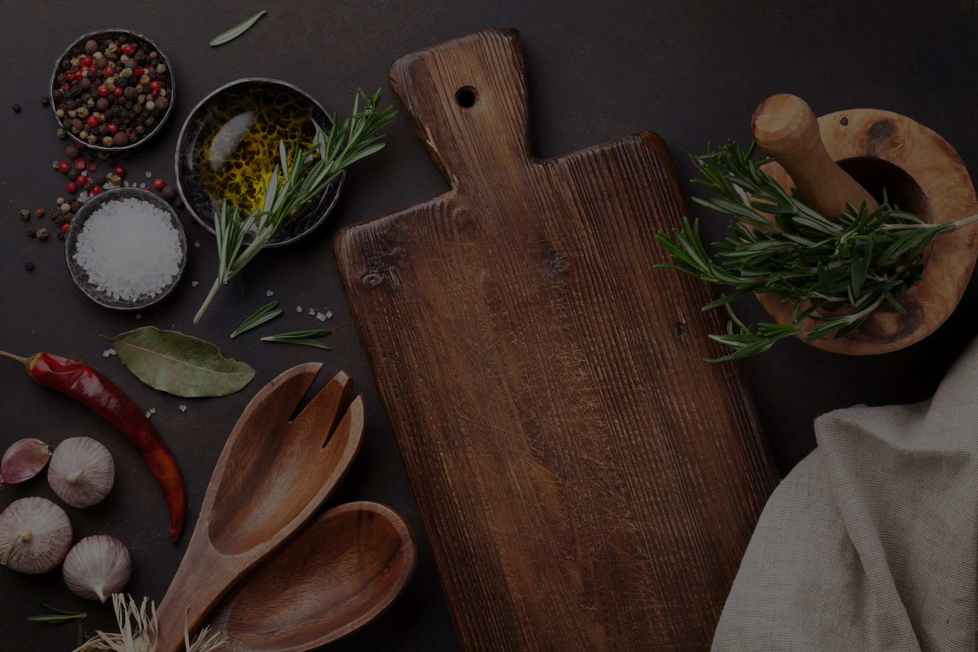 Cooking table with herbs spices and utensils